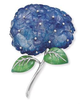 A DIAMOND AND PATE-DE-VERRE GLASS HYDRANGEA BROOCH, BY TIFFANY & CO. Designed as a purple and green pate-de-verre glass hydrangea blossom, decorated with collet-set diamonds, to the polished 18k white gold veining and stem Signed Tiffany & Co., France (BB)