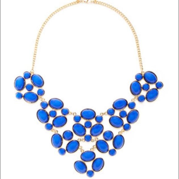 """Cara Couture Oval & Round Cluster Bib Necklace Great necklace in excellent condition!          Gold-tone base metal oval and round cluster bib necklace with resin stone details. Lobster clasp closure. Measurements: 18.25"""" long with 3"""" extension chain; 5.75"""" bib drop Cara Couture Jewelry Necklaces"""