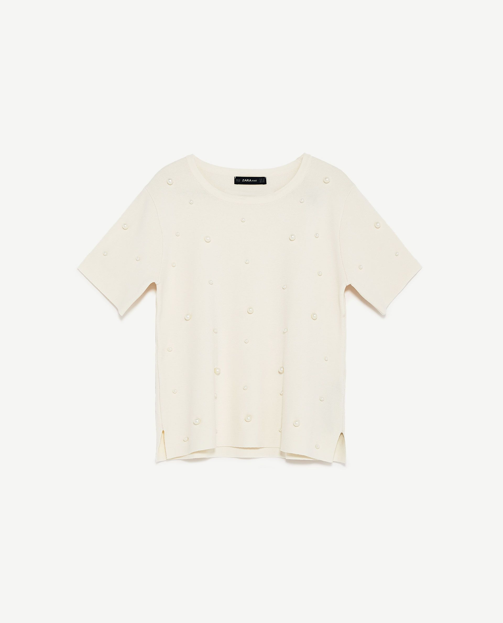 Zara S New Collection Is Major Shop Our Edit Now White Short Sleeve Jumper With Pearl Embelishment From Instyle Com Tops Knitwear Sale Womens Tops