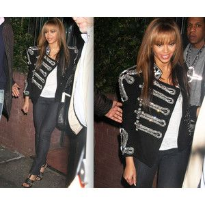 Beyonce in a twelve thousand dollar Balmain military jacket made with hundred's of crystal's.    http://www.polyvore.com