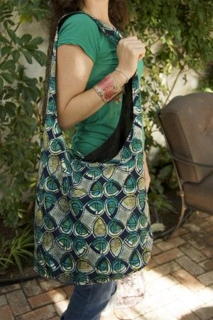 """This woman started teaching women in Tanzania how to make their own bags out of local fabric. The bags are called """"Tuko Pamoja,"""" and now many women who are touched by HIV/AIDS have a source of income for their families. Very cool!! Check out the article: http://hellogiggles.com/bags-for-a-cause"""