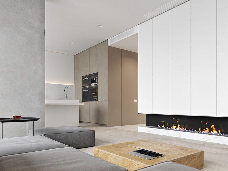 Cucina soggiorno open space, divano di colore grigio e camino ...
