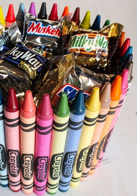 This DIY crayon candy jar is the perfect teacher'€™s gift you can make them for Halloween or the holiday season.
