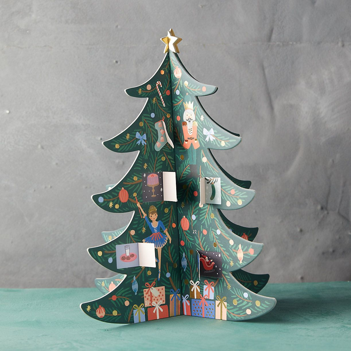 Count down the days until December 25th with this sweet advent calendar; revealing festive surprises in the Christmas tree as you go.- Paper, gold foil- Imported14