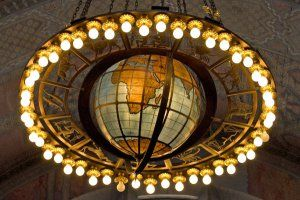 Globe Chandelier is in the rotunda of the Central library in LA. The Globe Chandelier hangs in the Rotunda and was designed by Goodhue Associates, modeled by Lee Lawrie and manufactured by the Thomas Day Company of Los Angeles. Historical Arts and Casting of Salt Lake City restored the Globe Chandelier in the 1980s. It is 9 feet in diameter and weighs one ton.