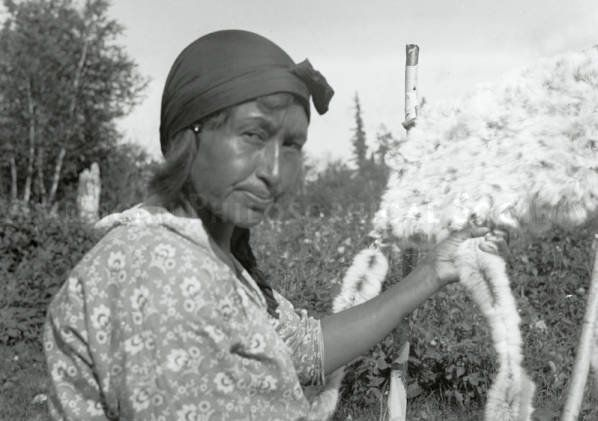 Ojibwa woman making a Rabbit-Skin Blanket - circa 1930
