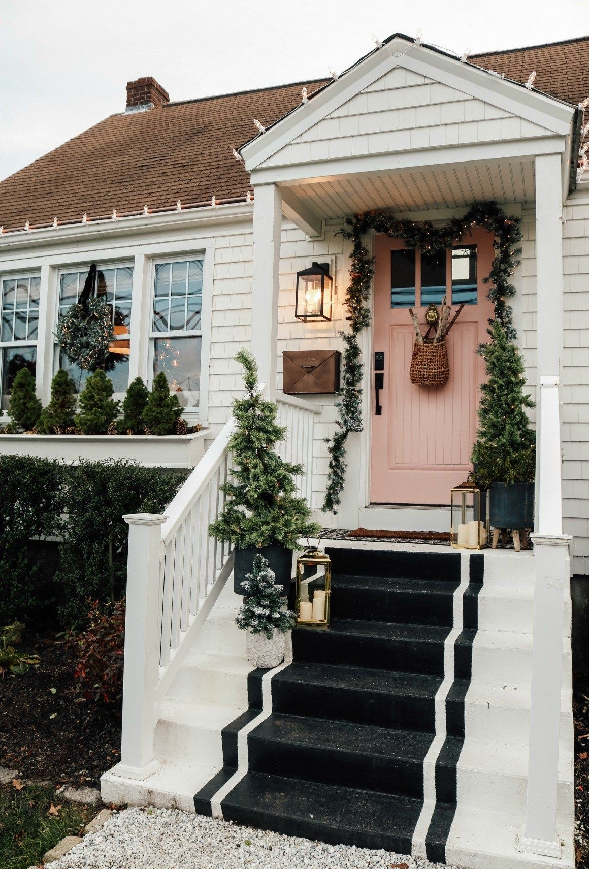 Decor on the Exterior of our Home Christmas Porch Decorating Ideas: Coastal classic Christmas ideas on the porch using flocked Christmas trees, rustic winter logs, and twinkly lights for a beautiful cozy Christmas entry and exterior!Christmas Porch Decorating Ideas: Coastal classic Christmas ideas on the porch using flocked Christmas trees, ru...