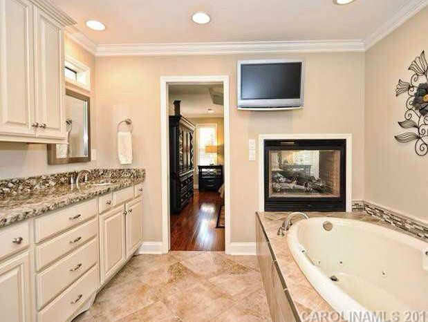 Master Bedroom With Bathroom double sided fireplace between master bedroom & bathroom