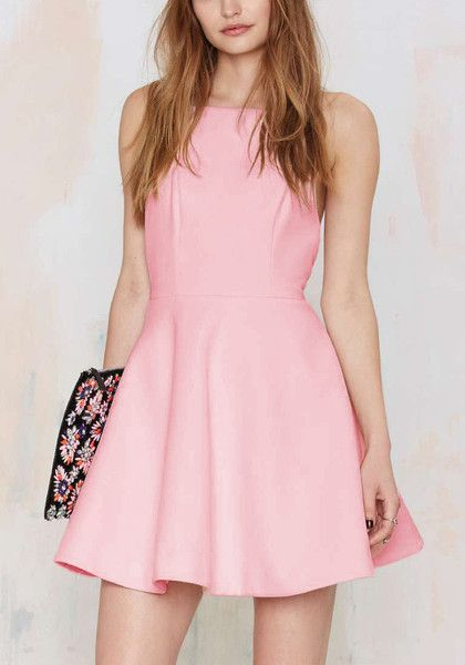When it comes to looking dainty and sweet, nothing does it better than pink. This pink cutaway neckline skater dress can do just that. It's styled with thin shoulder straps, partial lining and a back zipper.   Lookbook Store