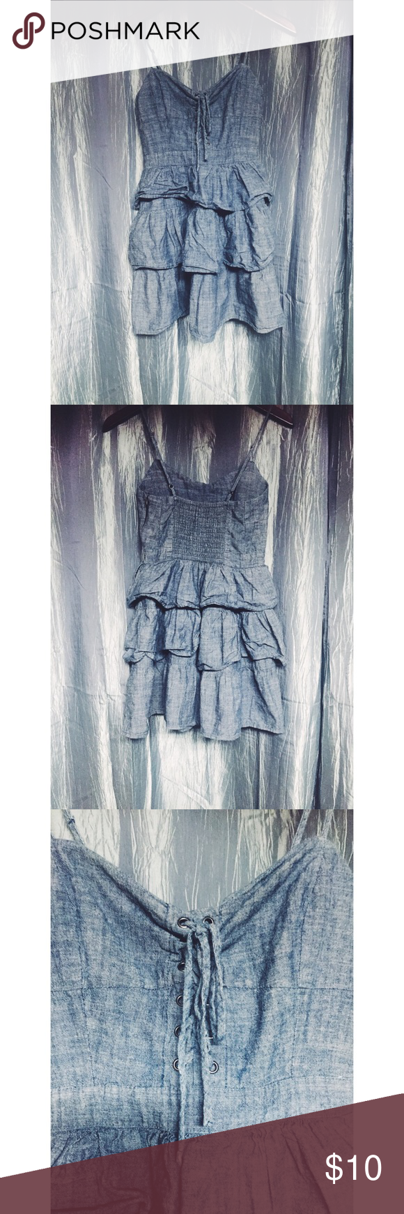Forever 21 Ruffle Dress! This dress is very fun! It is a chambray material. It laces up in the front and has built in padding! It is in great condition but I will add that it can sometimes be a challenge to iron. I suggest hang drying this one! Don't forget to check us out at maggiesuniqueboutique.weebly.com! Forever 21 Dresses Mini