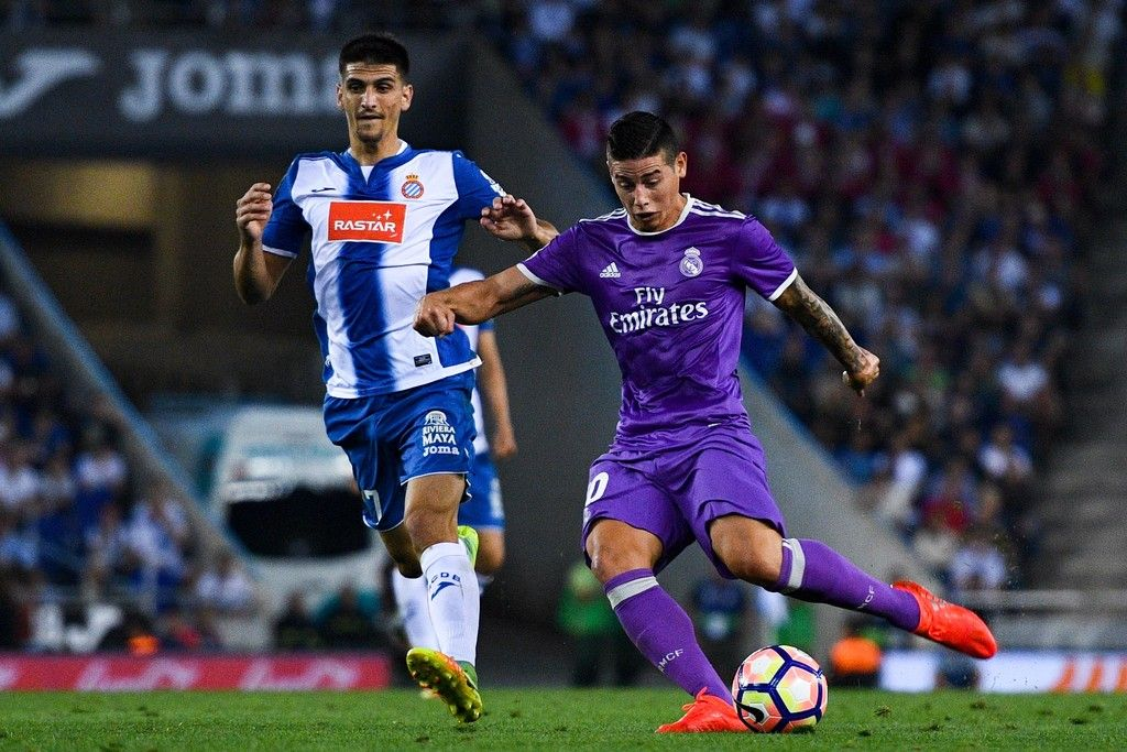 James Rodriguez of Real Madrid CF scores his team's first