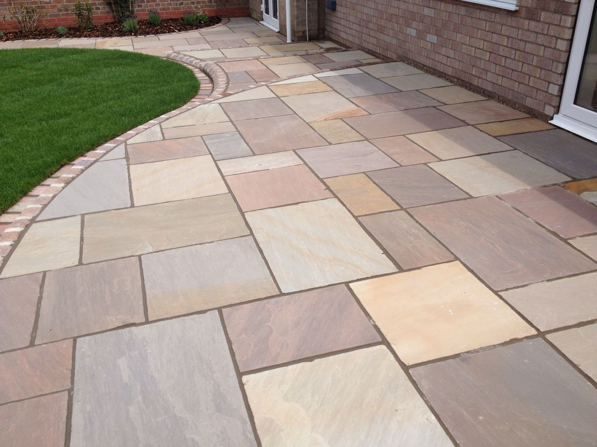 Indian sandstone with marshalls tegula setts and kerbs for Garden decking and slabs