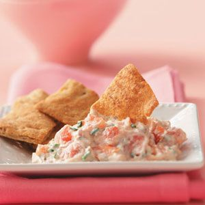 Roasted Garlic & Tomato Spread Recipe - Bold flavors and a creamy consistency make this spread a crowd-pleaser. Serve it warm or chilled with pita chips, crackers or breads