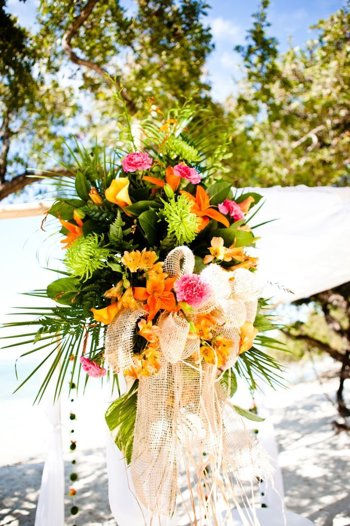 Tropical Beach Wedding Ceremony With Orange And Pink Flowers