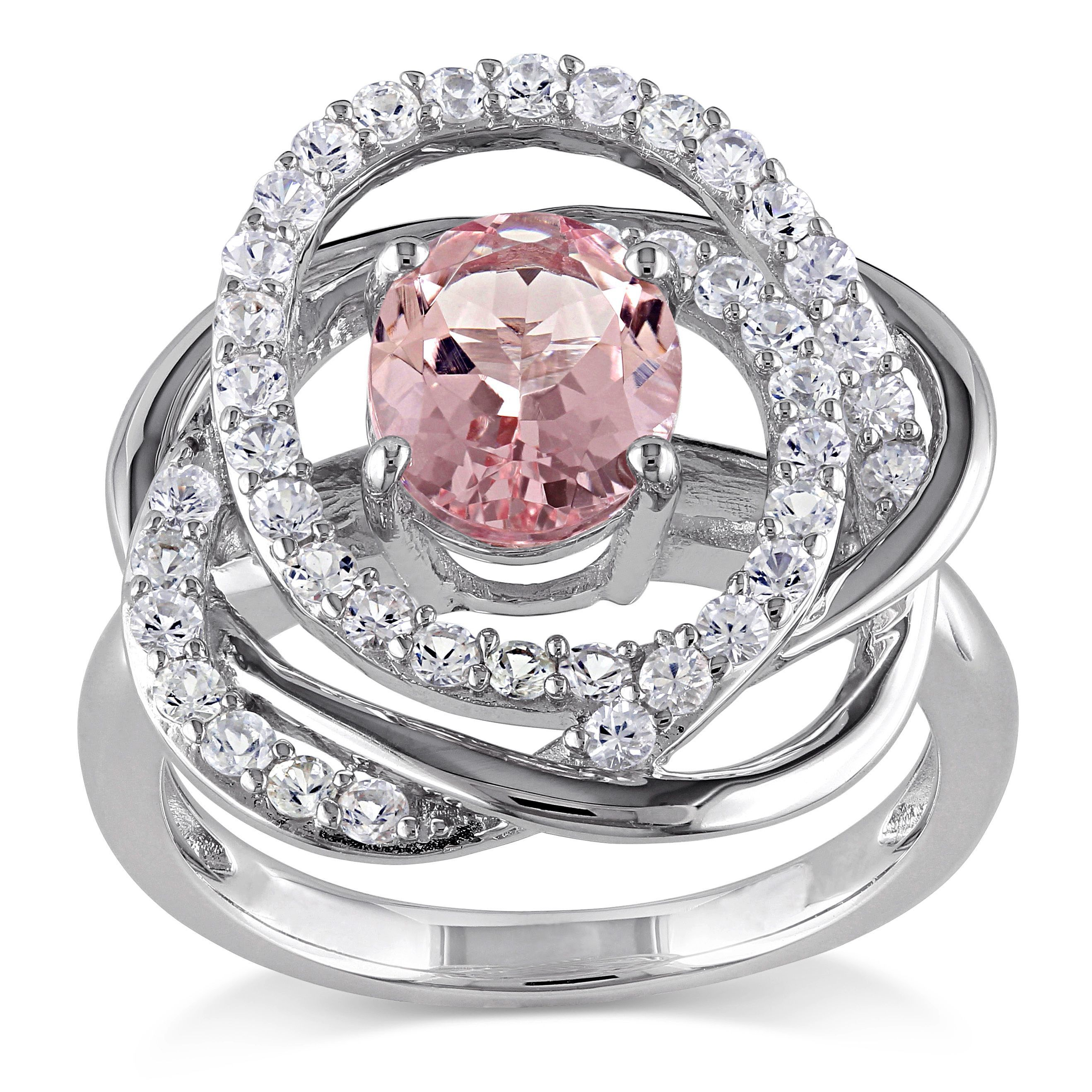 <li>Oval-cut morganite and round-cut white sapphires flower ring</li><li>Sterling silver jewelry</li><li><a><a href='http://www.overstock.com/downloads/pdf/2010_RingSizing.pdf'><span class='links'>Click here for ring sizing guide</span></a></li>
