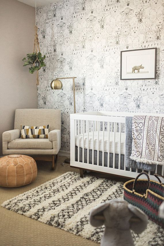 A neutral nursery in white gray and beige with a modern for Modern grey nursery