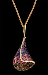 Amethyst, Garnet, and pink tourmaline in pink gold...luscious! #ericksonjewelers