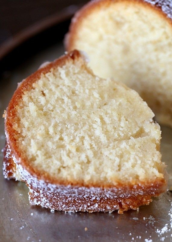 Kentucky Butter Cake is the perfect butter pound cake! Topped with a crunchy, sugary glaze it's amazing on it's own, topped with strawberries or frosting!