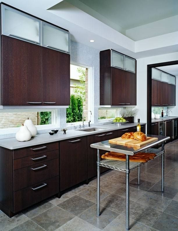 the frost glass cabinets adds light to the open concept room and avoids that the dark wood on kitchen remodel light wood cabinets id=89487
