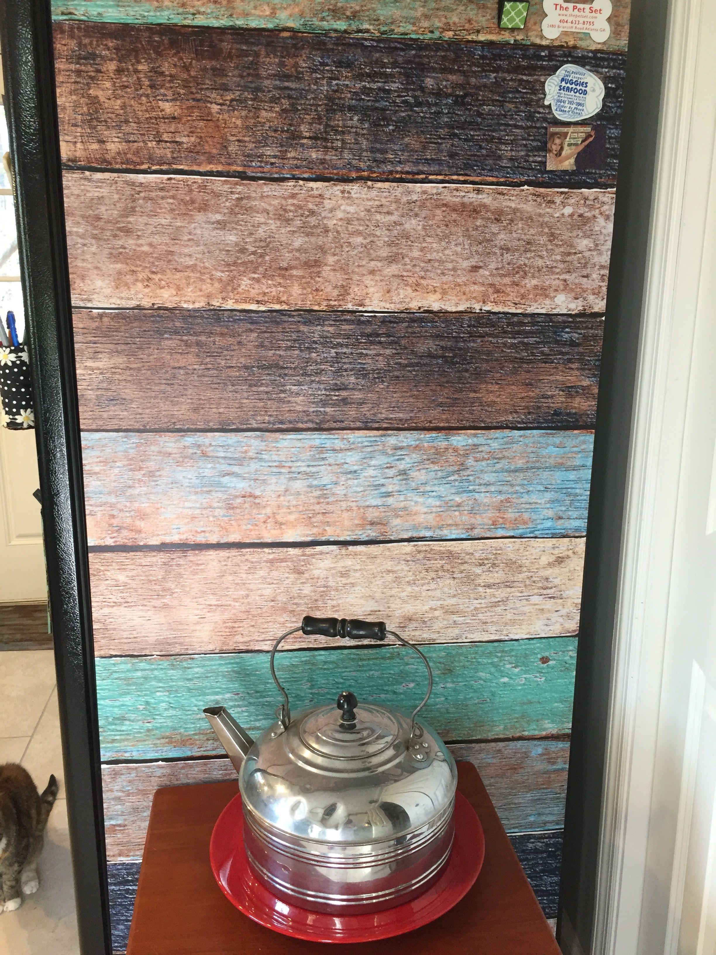 Barnwood cover on side of fridge. Old Reverware