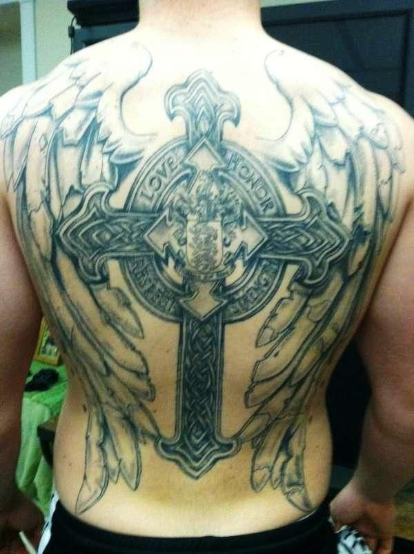 I love how the wings look like stone probably not this for Big cross tattoos