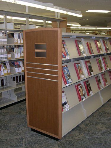 Periodical Shelving With Custom Wood End Panel. ==Library