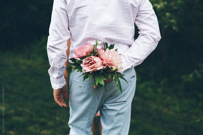 man holding a peony bouquet behind his back by Kelly Knox for ...