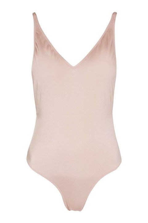 Keep up with the barely-there motif of summertime and sport this nude one-piece from Topshop.