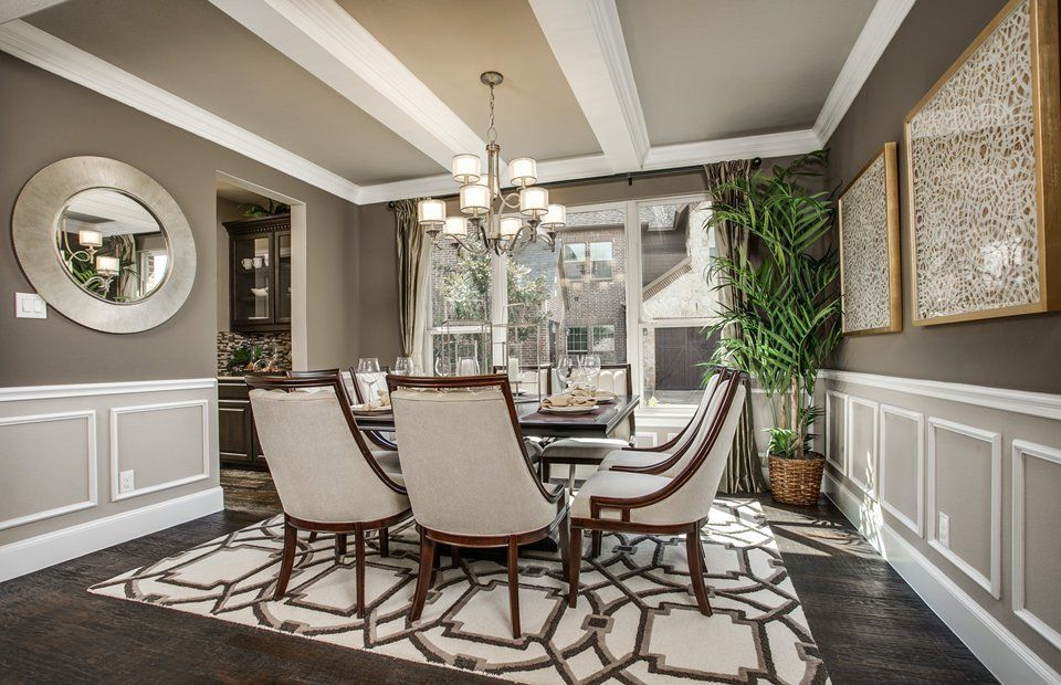 Transitional dining room with global views arabesque rug - Dining room rug ideas ...