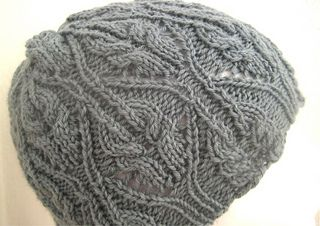 87ed08b5a55 Ravelry  Lydia Cabled Hat pattern by Suzie Sparkles