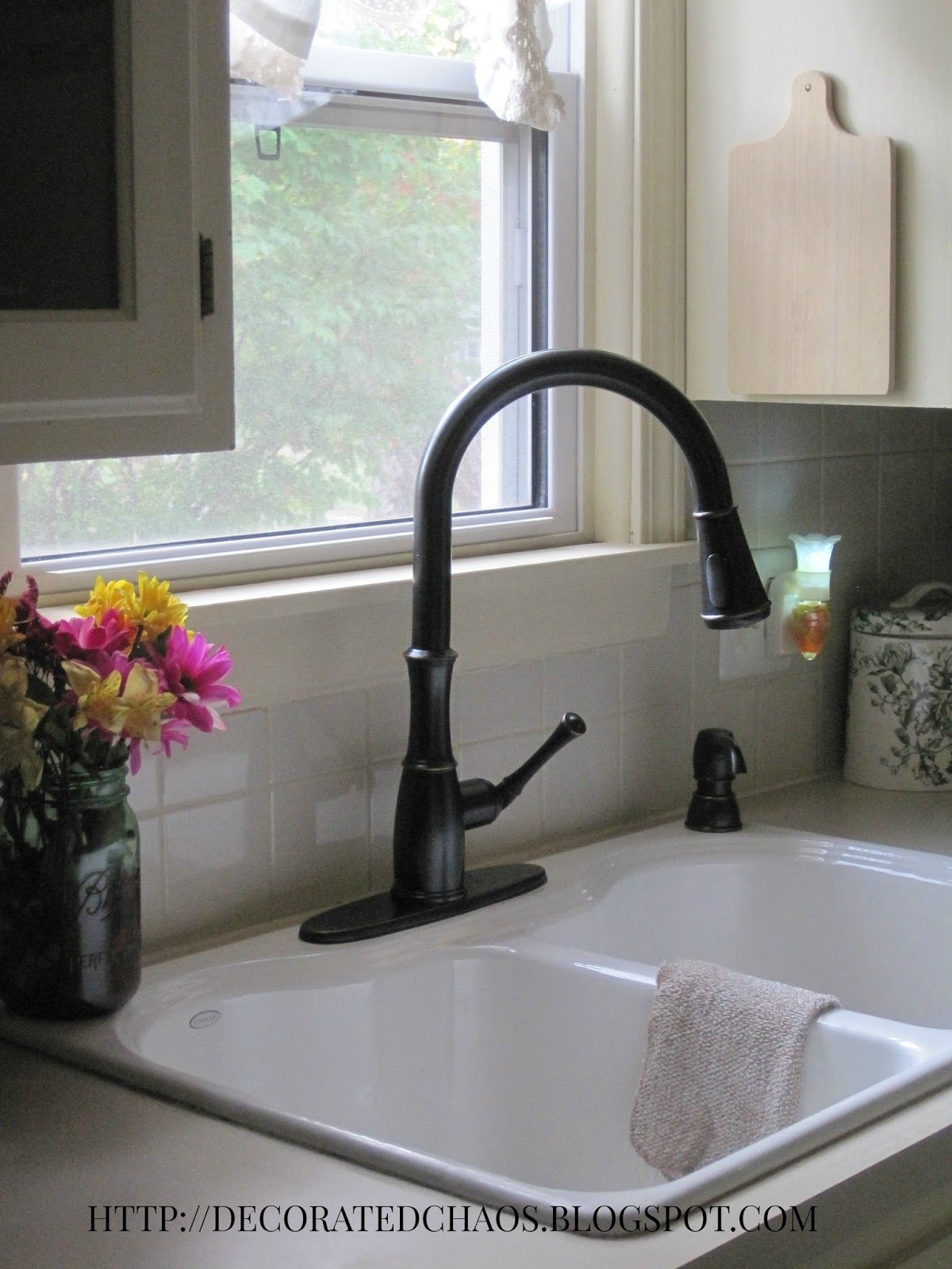 Kitchen Faucet   Decorated Chaos New Pfister Faucet In Tuscan Bronze And  White Cast Iron Sink.