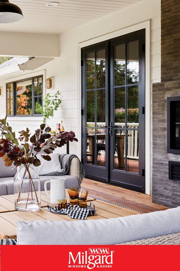 Black French Patio Doors Add A Dark Elegance To This Farmhouse Patio French Doors Are Availabl Patio Door Coverings Sliding French Doors French Doors Exterior