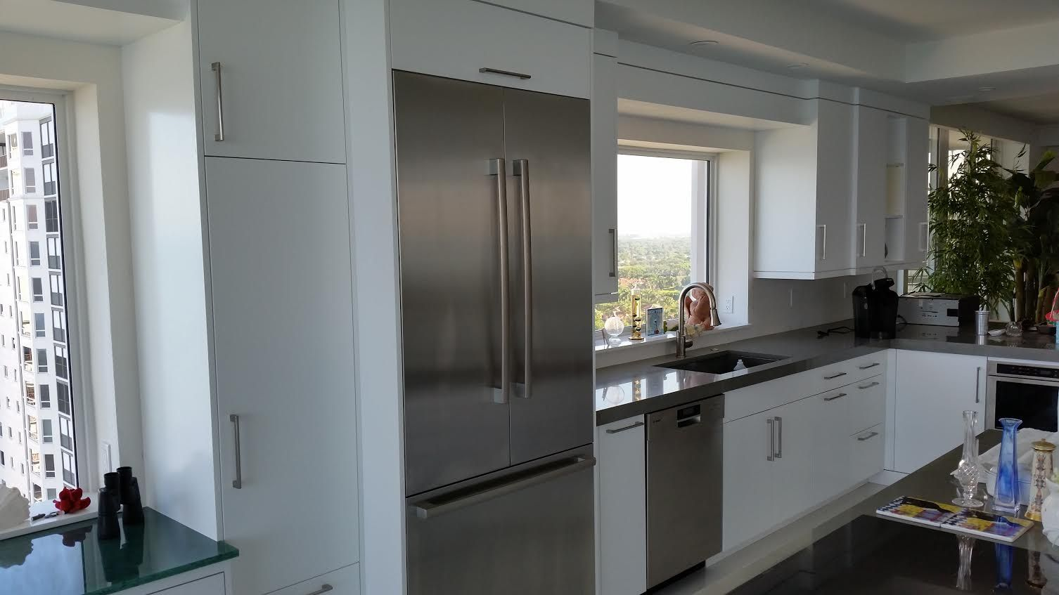 High Gloss (60 sheen) painted white kitchen cabinetry ...