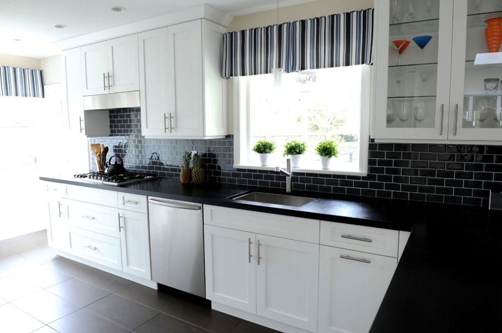 Amazing Black Glass Subway Tile Backsplash With Granite Countertop