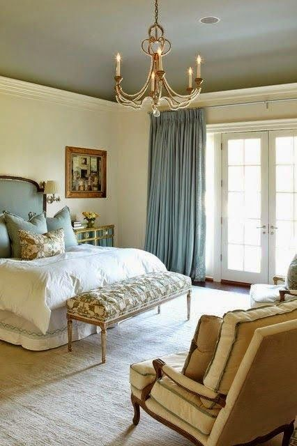 Very elegant & well done bedroom in a neutral palate with blue accents. Love the ceiling & chandelier.