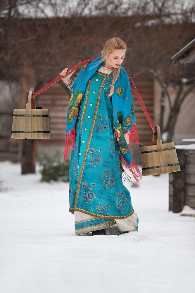 Like in old Russia: a peasant girl carrying wooden buckets of water with a yoke. #Russian