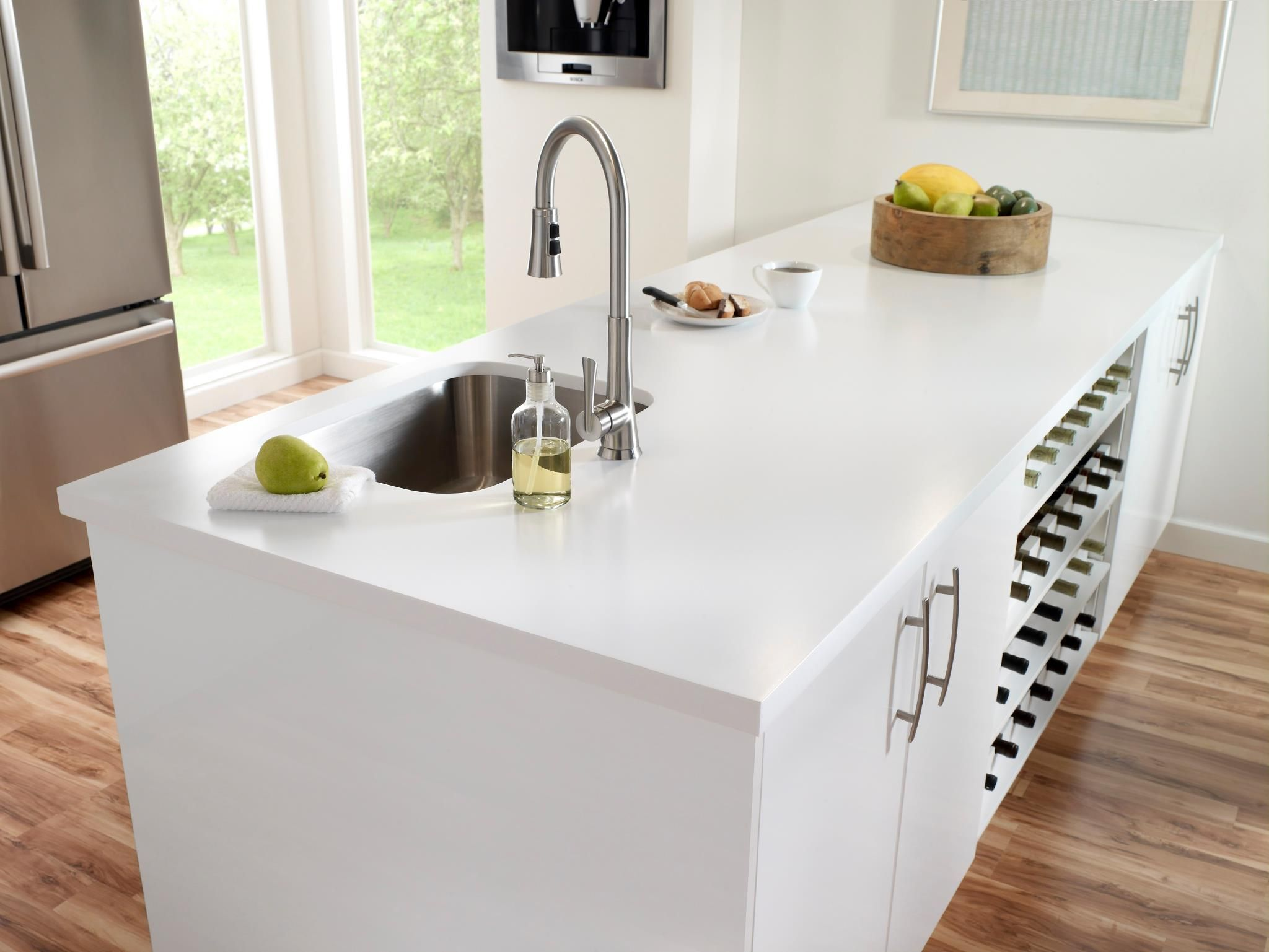 Corian® kitchen island in Designer White - complete with ample ...