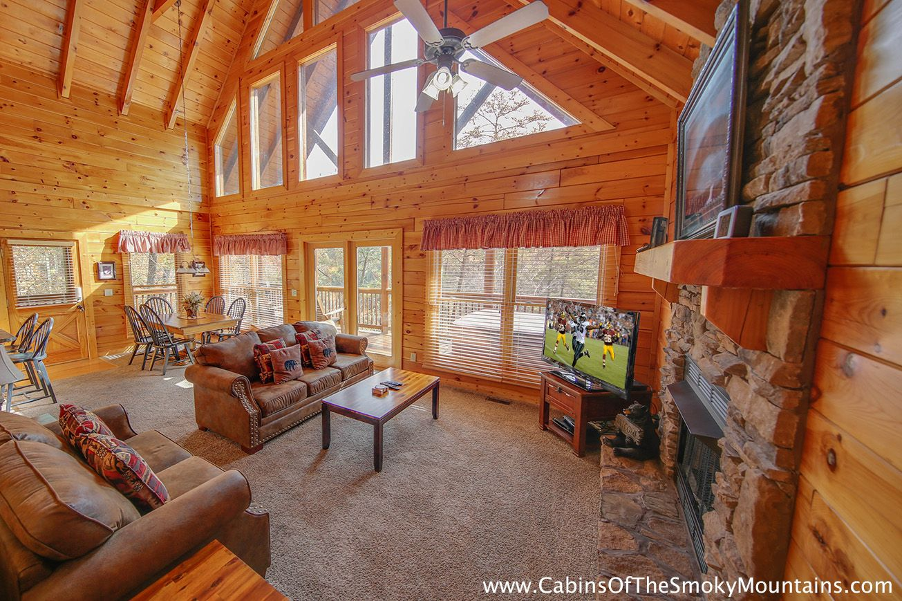 An allweather living room fireplace inside, hot tub on