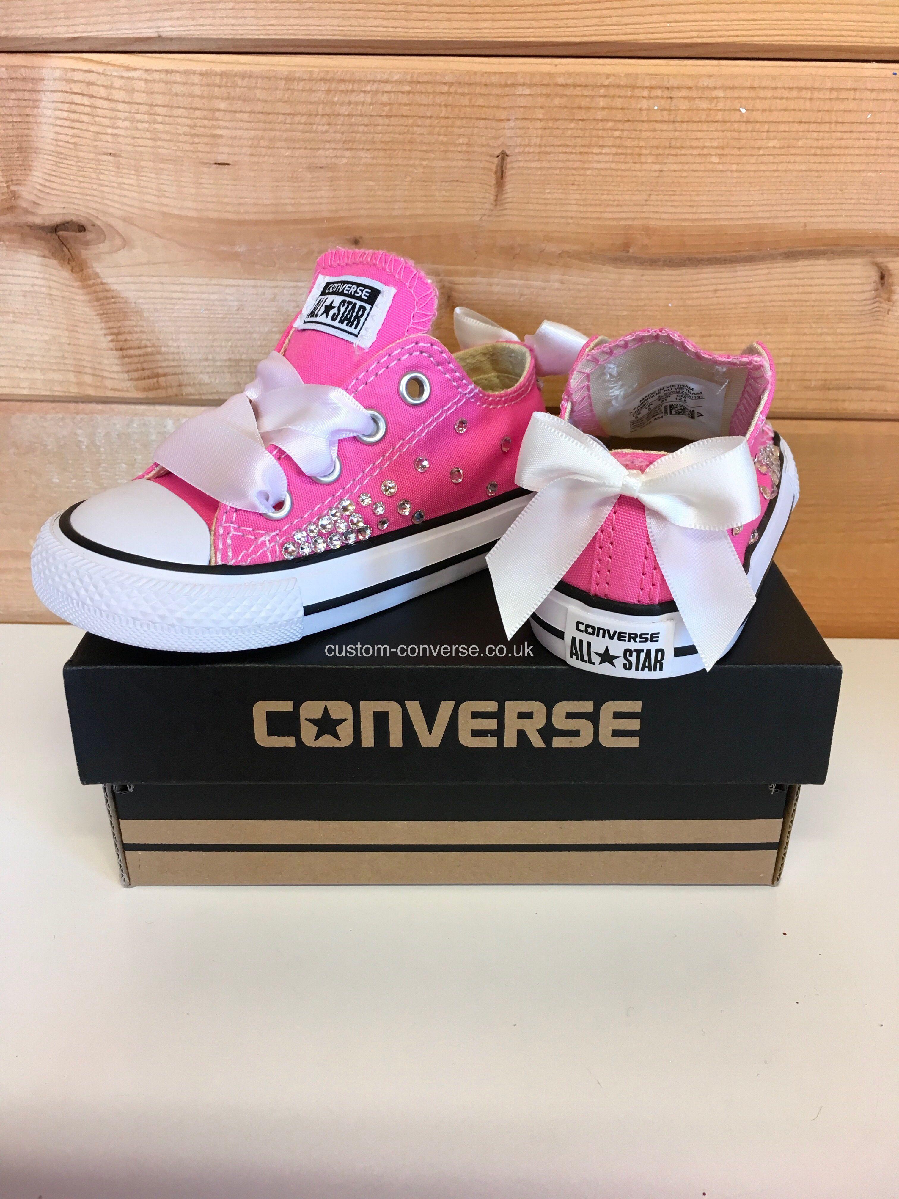 b26dabd138c0 Pink girls Swarovski low top converse with white ribbon laces and bows   weddingconverse  flowergirl