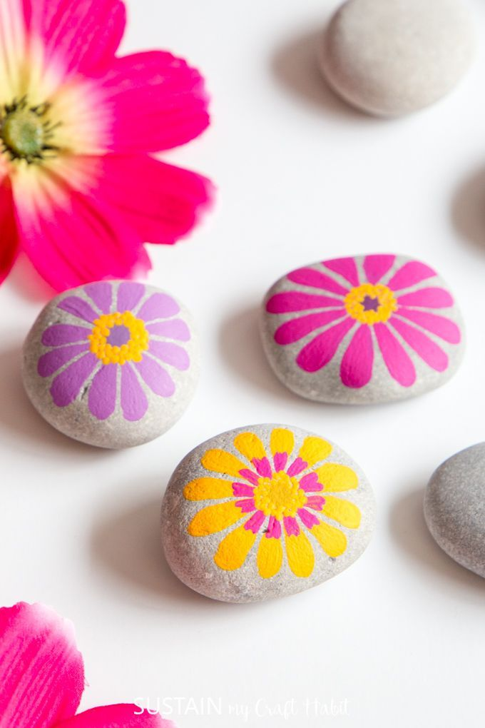 Colourful and Cheerful Flower Painted Rocks is part of Painted rocks, Rock flowers, Easy flower painting, Rock painting art, Painted rocks kids, Flower painting - Scatter touches of colour and cheer throughout your home and garden with these easy flower painted rocks inspired by zinnia blooms