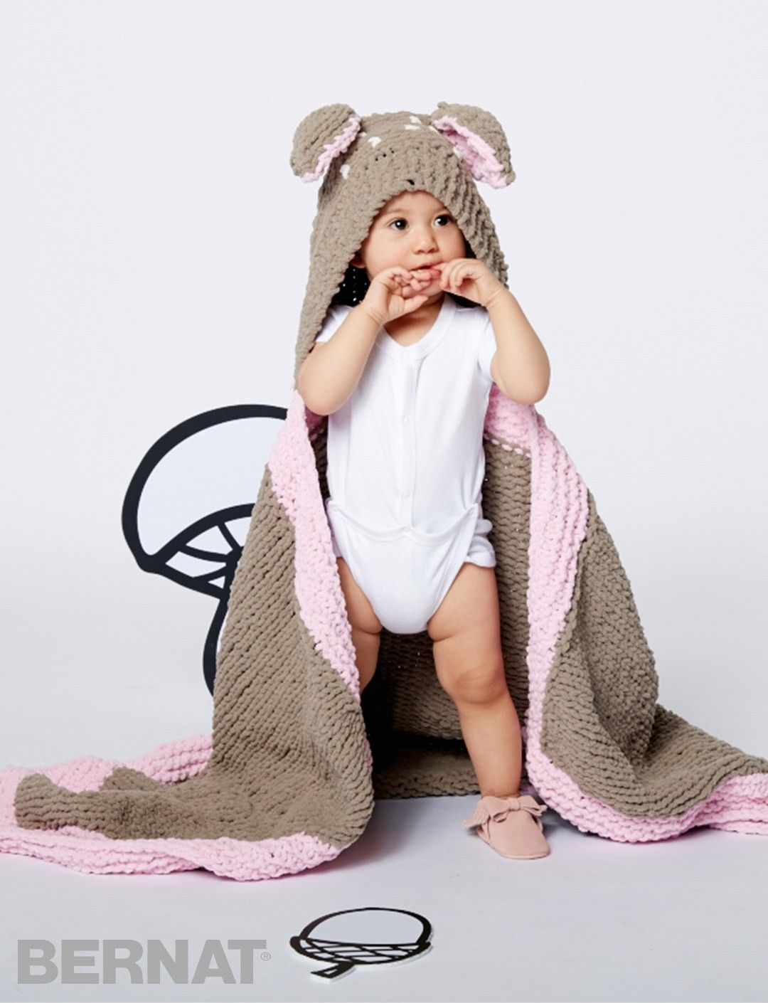 This hooded blanket is seriously snuggly - knit in Bernat Baby ...