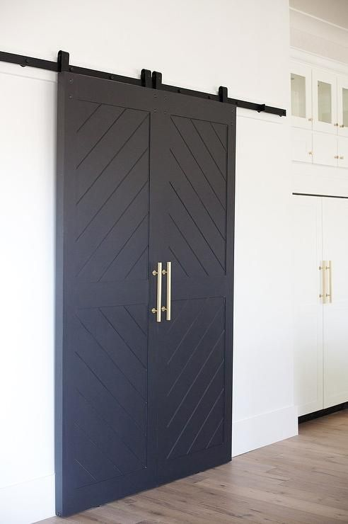 Chic Kitchen Features A Walk In Pantry Finished With Black Chevron Sliding Doors On Rails