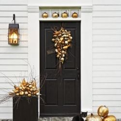 The hints of gold in the Halloween front porch decorations are beautiful!