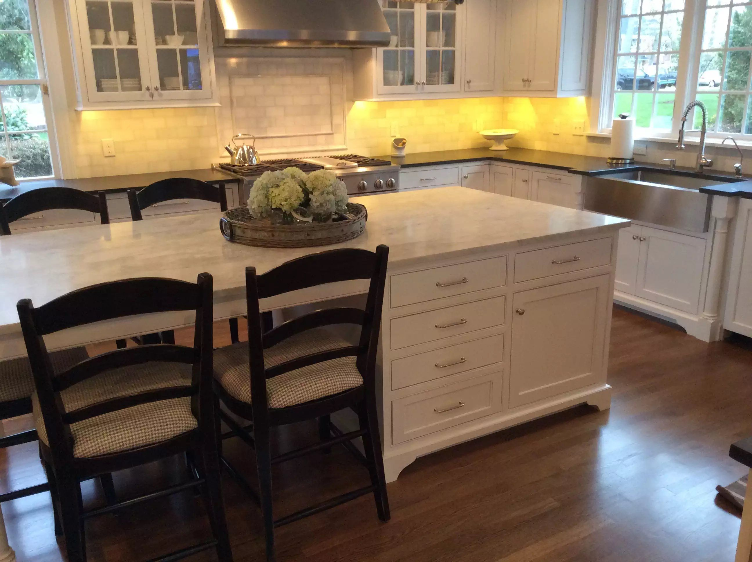 Custom White Kitchen With Seated Island By Prestige Cabinets