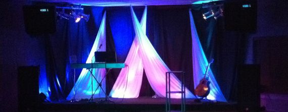 Just one idea of stage design using fabric  | Church Decor