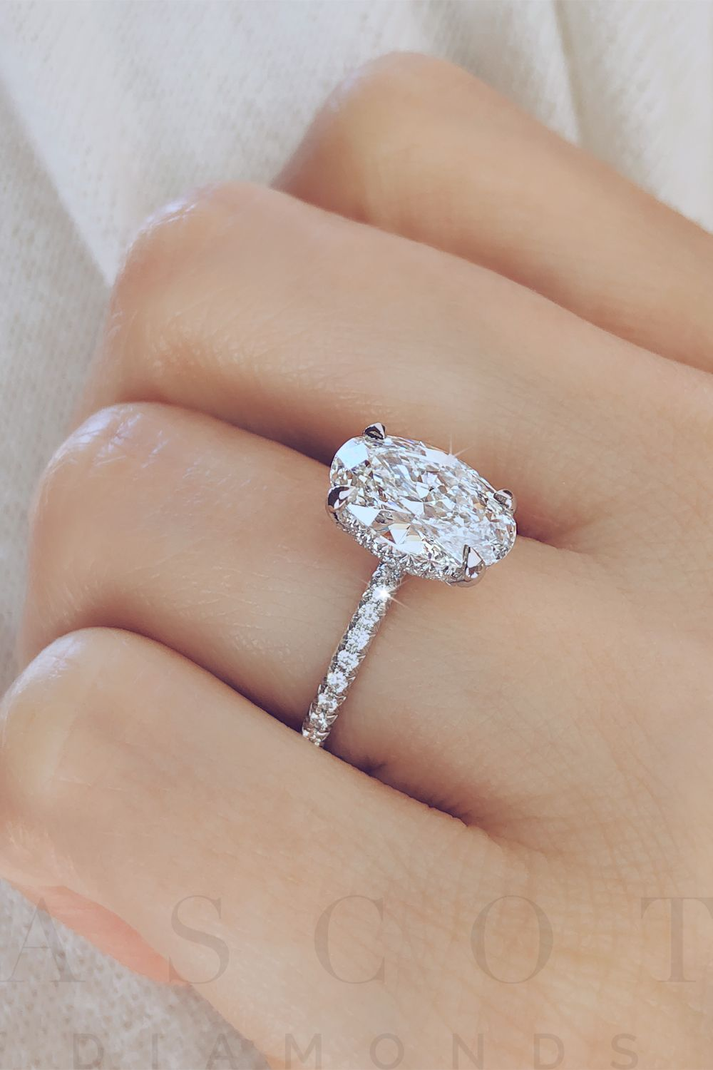Oval cut diamond solitaire with a hidden halo. By Ascot Diamonds