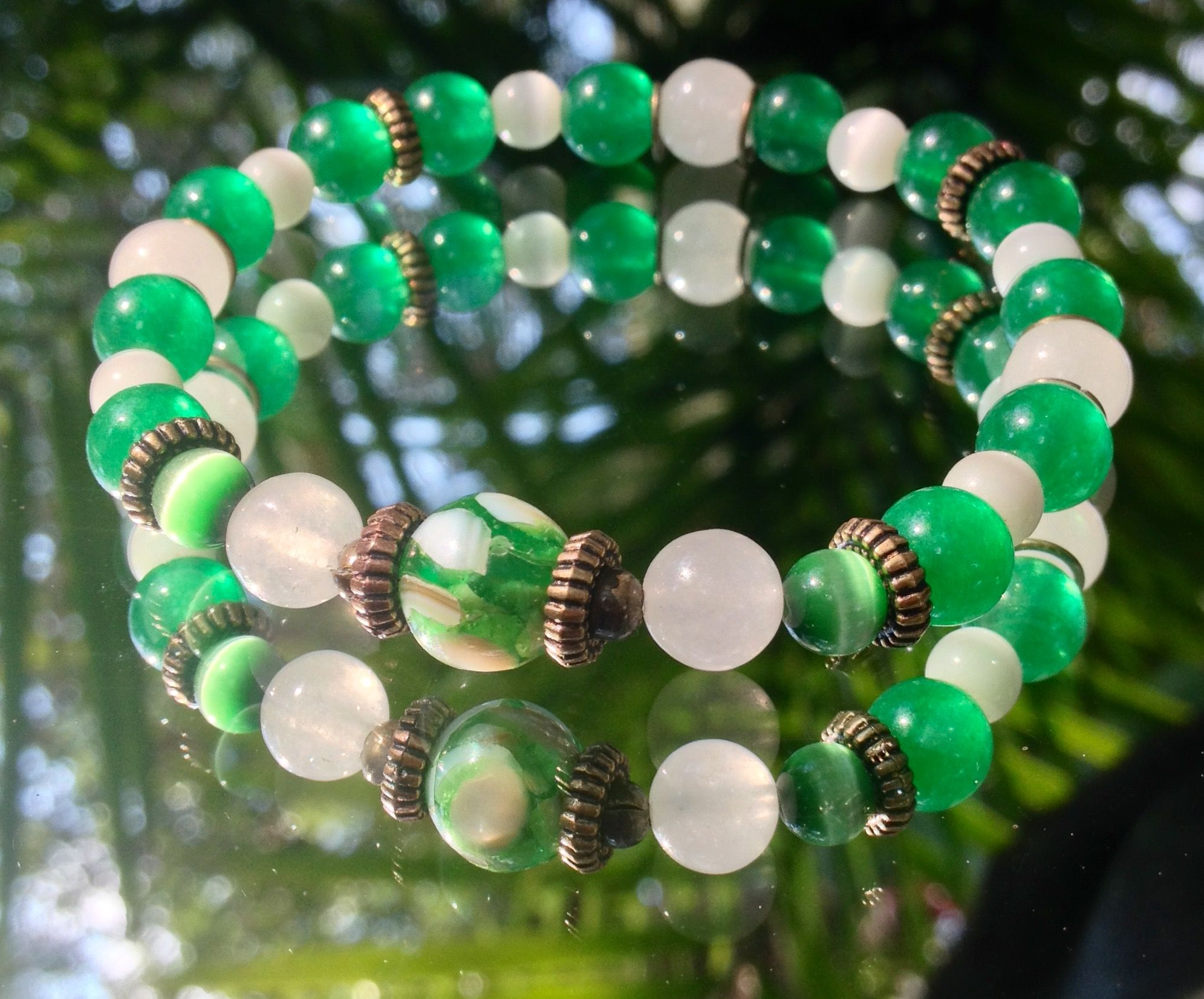 10 Jade and milky Quartz. White and green cats eye