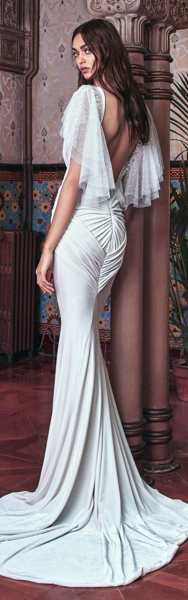 A skin tight double velvet mermaid gown with a plunging V neckline ...