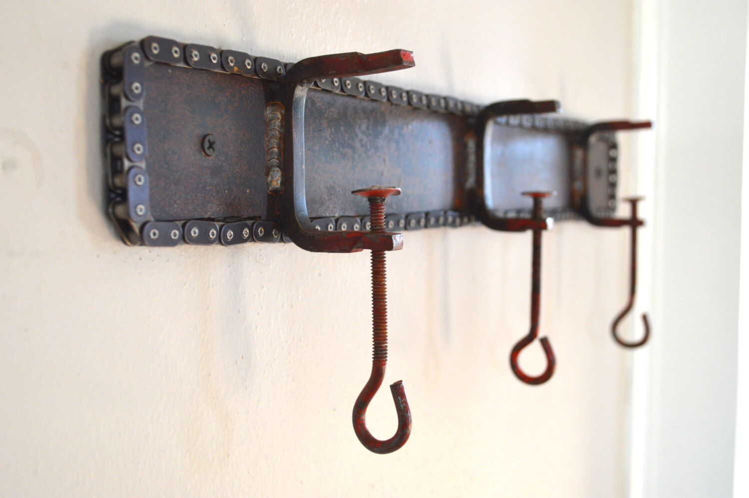Unique Rustic Industrial Shelf w/ Chain Trim & Red Clamp Hooks  Reclaimed Rusty Metal Coat Rack, Purse Hook, Towel Rack, Hat Rack, Decor by DennisJohnIndustrial on Etsy https://www.etsy.com/listing/256430364/unique-rustic-industrial-shelf-w-chain