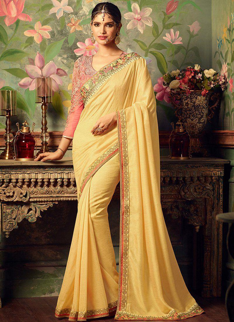 Yellow silk saree light pink and yellow embroidered silk saree features a beautiful